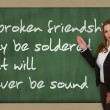 Teacher showing  A broken friendship may be soldered but will on — Stock Photo