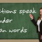 Teacher showing Actions speak louder than words on blackboard — Stock Photo