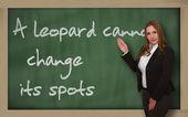 Teacher showing A leopard cannot change its spots on blackboard — Stock Photo
