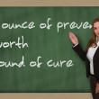 Teacher showing An ounce of prevention is worth a pound of cure — Stock Photo