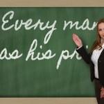 Teacher showing Every man has his price on blackboard — Stock Photo