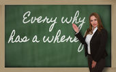 Teacher showing Every why has a wherefore on blackboard — Photo
