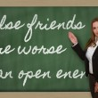 Teacher showing False friends are worse than open enemies on bla — Stock Photo