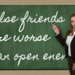 Teacher showing False friends are worse than open enemies on bla — Stock Photo #26023665