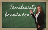Teacher showing Familiarity breeds contempt on blackboard — Foto Stock