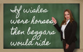 Teacher showing If wishes were horses, then beggars would ride o — Stock Photo