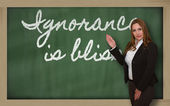 Teacher showing Ignorance is bliss on blackboard — Stock Photo