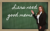 Teacher showing Liars need good memories on blackboard — Stock Photo