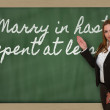 Teacher showing Marry in haste, repent at leisure on blackboard — Stock Photo