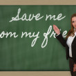 Teacher showing Save me from my friends on blackboard — Stock Photo #26033857