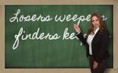 Teacher showing Losers weepers, finders keepers — Stock Photo