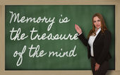 Teacher showing Memory is the treasure of the mind on blackboard — Stockfoto