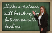 Teacher showing Sticks and stones will break my bones but names — Stock Photo