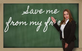 Teacher showing Save me from my friends on blackboard — Stockfoto