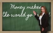Teacher showing Money makes the world go around on blackboard — Φωτογραφία Αρχείου