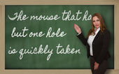 Teacher showing The mouse that has but one hole is quickly taken — Stock Photo