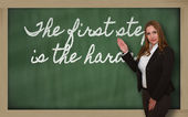 Teacher showing The first step is the hardest on blackboard — Stock Photo