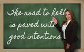 Teacher showing The road to hell is paved with good intentions o — Stock Photo