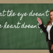 Teacher showing What eye doesn t see, heart doesn t grie — Stock Photo #26041059