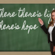 Teacher showing Where there s life there s hope on blackboard — Foto de Stock