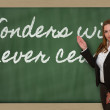 Teacher showing Wonders will never cease on blackboard — Stock Photo #26041961