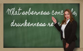 Teacher showing What soberness conceals, drunkenness reveals on — Stock Photo