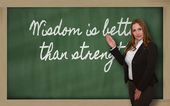 Teacher showing Wisdom is better than strength on blackboard — Foto Stock