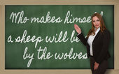 Teacher showing Who makes himself a sheep will be eaten by the w — Stockfoto