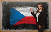 Teacher showing flag ofCzech on blackboard for presentation mark — Stock Photo
