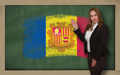 Teacher showing flag ofandorra on blackboard for presentation ma — Stock Photo