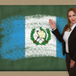 Teacher showing flag ofguatemala on blackboard for presentation  — Stock Photo