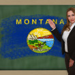 Teacher showing flag ofmontana on blackboard for presentation ma — Stock Photo