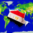 Fist in color  national flag of egypt    punching world map — Stockfoto
