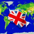 Fist in color national flag of united kingdom punching world — Stock Photo