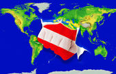Fist in color national flag of austria punching world map — Stock Photo