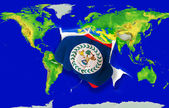 Fist in color national flag of belize punching world map — Stock Photo