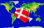 Fist in color national flag of denmark punching world map — Stock Photo