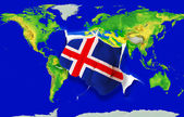 Fist in color national flag of iceland punching world map — Stock Photo