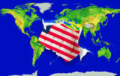 Fist in color national flag of liberia punching world map — Stock Photo