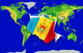 Fist in color national flag of moldova punching world map — Stock Photo