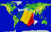 Fist in color national flag of romania punching world map — Stock Photo
