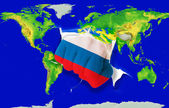 Fist in color national flag of russia punching world map — Stock Photo