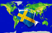 Fist in color national flag of sweden punching world map — Stock Photo