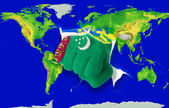 Fist in color national flag of turkmenistan punching world m — Stock Photo
