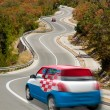 Car on road in national flag of croatia colors — Stock Photo #26638809