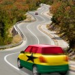 Car on road in national flag of ghana colors — Stock Photo
