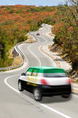 Car on road in national flag of afghanistan colors — Stock Photo