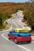 Car on road in national flag of columbia colors — Stock Photo