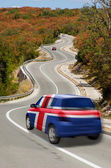 Car on road in national flag of iceland colors — Stock Photo