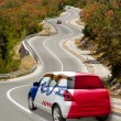 Stock Photo: Car on road in flag of americstate of iowcolors